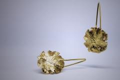 Pendientes orbiculares en oro amarillo